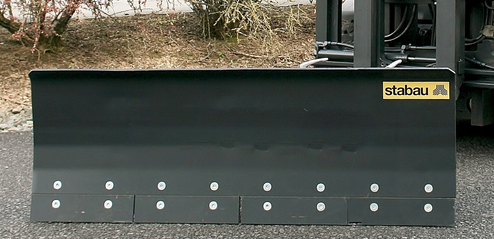 Snow Plow with spring-loaded steel shield trim